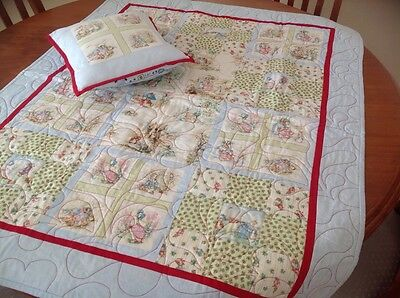 Handmade patchwork baby's cot quilt in Beatrix Potter design
