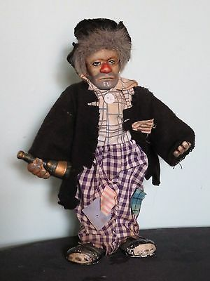 Vintage Sad Clown Figure. Holding a Bottle. 10 inches high