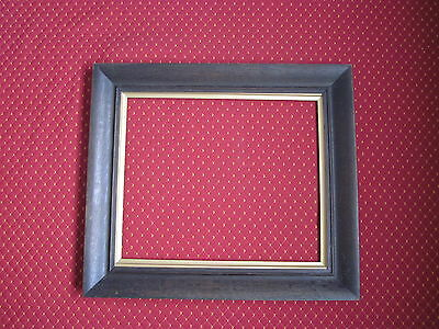 AN EDWARDIAN [ early 20th c] OAK PICTURE FRAME WITH BRONZE GILT SLIP