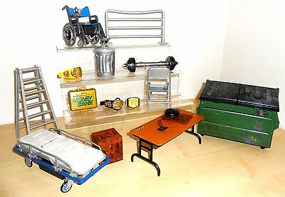 Set of WWE accessories inc. dumpster, breakable table, ladders etc.