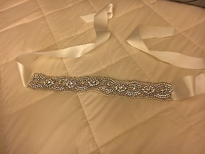"a.b. Ellie ""Rori"" Ivory Sash with hand sewn crystal rhinestones. NEVER BEEN WORN"
