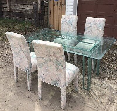 "Glass dining table and four chairs, 72"" L x 42"" W"