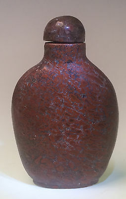 Chinese carved brick-red hardstone snuff bottle