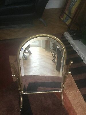 a brass dressing table mirror