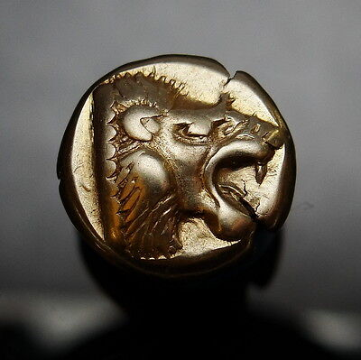 Roaring Lion of Mytilene and Cow. Ancient Greek gold coin. High Grade. Superb.