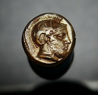 Female Amazon and God Ares. Superb Ancient Greek gold coin.High Grade. Superb.