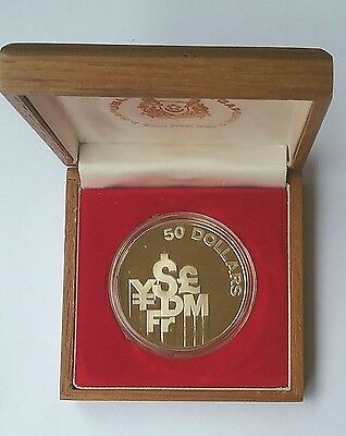 1981 Singapore 50 Dollar Silver coin in teak box