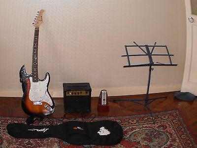 Electric guitar combination with stand, amplifier, soft case and metronome.