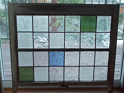 Stained glass window in timber frame