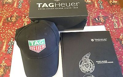 Genuine Tag Heuer cap and Tag Heuer book.