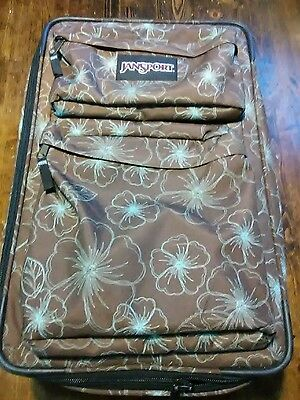 """Jansport 22"""" Wheeled Luggage brown and  Blue pattern."""