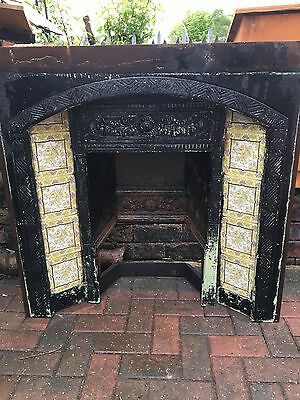 Vintage cast iron fireplace with tiles