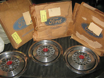 Three Ford Mustang Hubcaps in their original boxes NOS