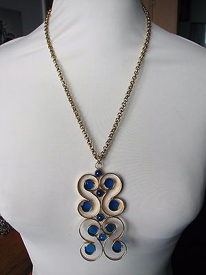 Vintage 1970s Huge Gold Tone Metal Swirly Clear Blue Resin Pendant