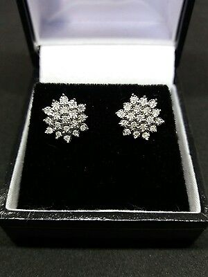 9CT new white gold  1/4ct diamond cluster earrings. £285.00