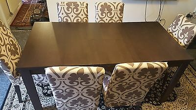 dining table and chairs with covers