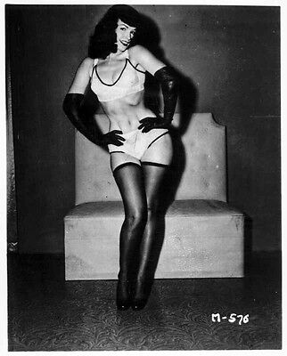 Bettie Page Posed in White Silk Lingerie and Black Silk Gloves with Hands on the