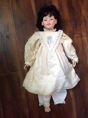 Collectible  doll by artist  Elke Hutchens with author's signature