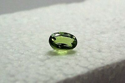 beautiful stunning  peridot 5x7 oval very good color green lime carat 1.00 appox