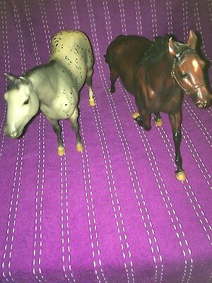Two plastic Breyer horses