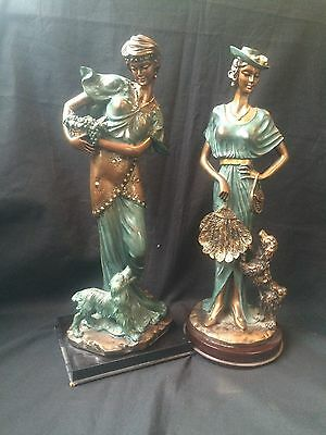 Pair art nouveau french metal figurines with dogs. Beautiful dark green patina