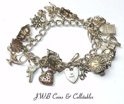 Vintage Sterling Silver Charm Bracelet With 27 Charms - 69 Grams