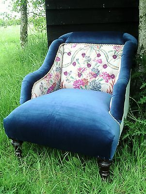 Beautiful Re-upholstered Victorian armchair in navy velvet and antique florals