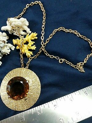Large brown stone gold tone pendant and necklace, one prong broken