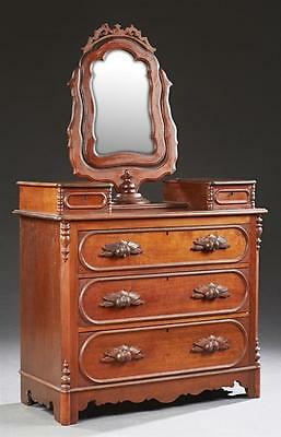 American Victorian Carved Walnut Dresser, c. 1880, the shaped mirror ... Lot 178