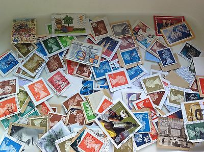 Large collection of GB stamps mostly on papetn
