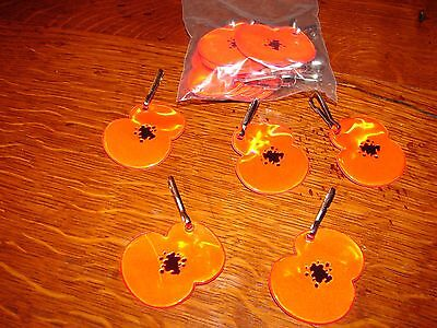 Royal British Legion clip on reflector poppies in brilliant red.