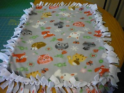 Handmade baby fleece tie blanket of woodland animals for a newborn