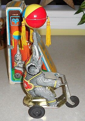 Elephant On Bike Wind Up Tin Toy Ball spins!