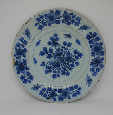 Early 18th C Delft pancake plate An early tin-glazed earthenware blue and white