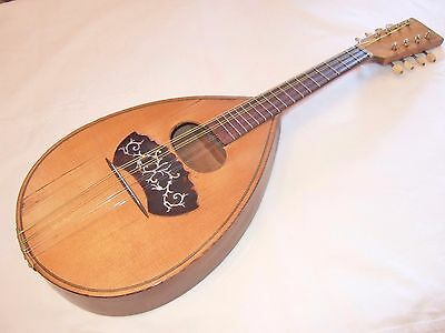 Very lovely old flat back Mandolin in good playing order & condition lovely tone