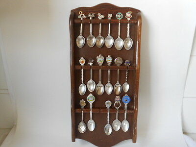 16 colectable silverplate souvenir spoons and display case