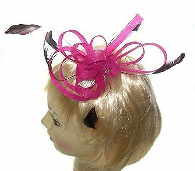 Pink loops fascinator with feather tendrils set on a ribbon bound Wedding Races