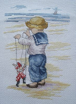 Completed cross stitch - All Our Yesterdays - PUPPETEER / MARIONNETTE