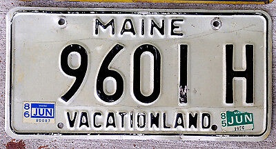"""Black on White Maine License Plate """"Vacationland"""" with 1985 and 1986 Stickers"""