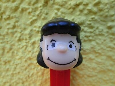 PEZ   small feet   LUCY WHITE EYES                          MINT CONDITION