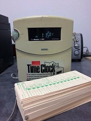Royal Eletronic Time Clock TimeMaster TC100 With a stack of time cards.