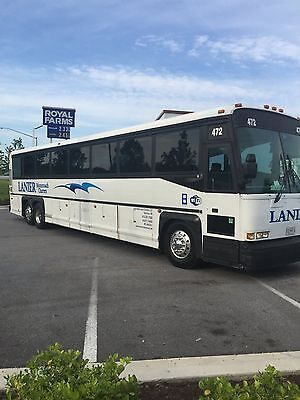 1998 MCI 102DL3 55 Passenger Motorcoach Bus road ready with plug outlets