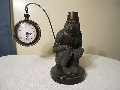 Unique Monkey Wearing A Sleeveless Jacket And Fez With Clock Hanging From Tail