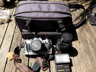Canon AE1 SLR with two lenses (Canon and Vivitar zoom) and a camera bag