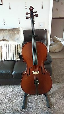 full size cello, stand and travel case.