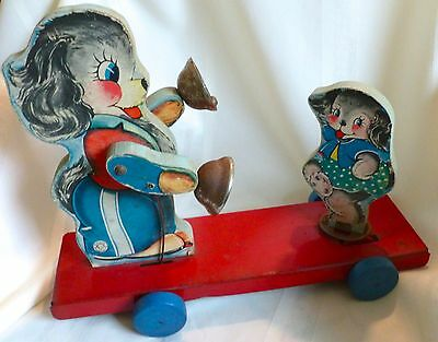 Vintage HILL BRASS CO Wood and Metal PULL TOY Puppy Litho Animated