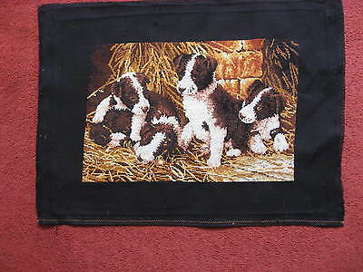 Completed cross stitch kit of collie type puppies