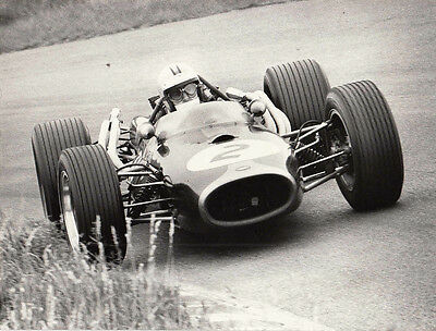 DANNY HULME DRIVING SINGLE SEATER RACING CAR No.2, PERIOD PHOTOGRAPH.
