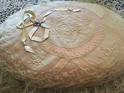 Normandy lace pillow with a delicate pink fabric pillow to peak through the lace