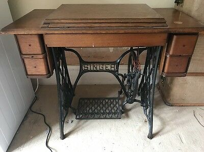 Early 1900 vintage singer sewing machine and table